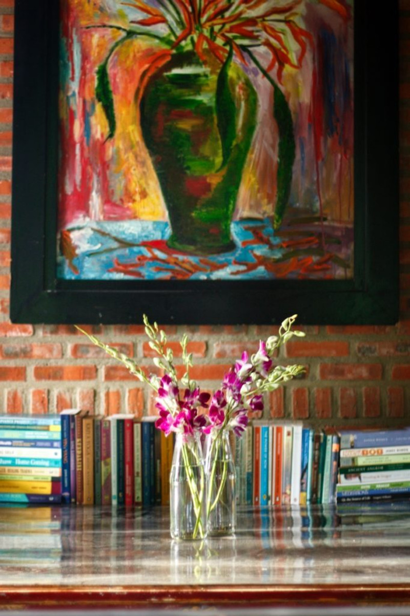 A photograph of the wellness library books in the communal snug at the Gratitude Vietnam Wellness Retreat Venue