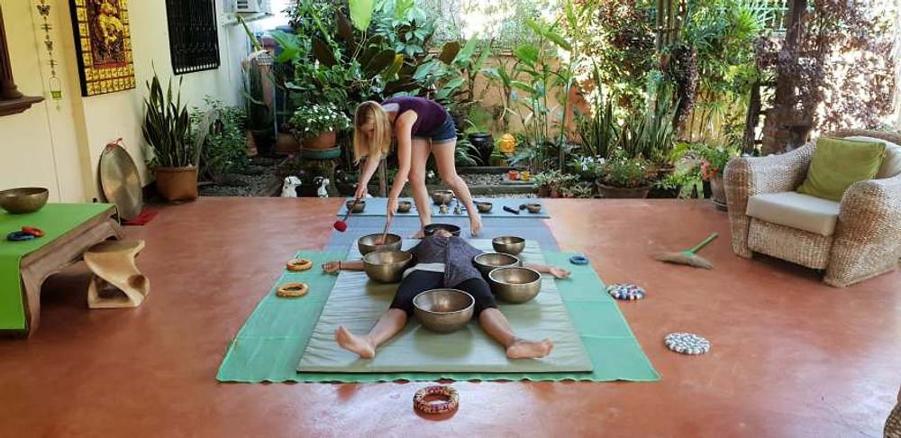Naomi training on Tibetan Singing Bowls during a sound healing course.