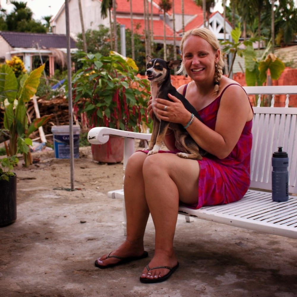 Hannah and the therapy dog 'Poppet' in the garden of the Gratitude Vietnam Retreat Venue in Asia