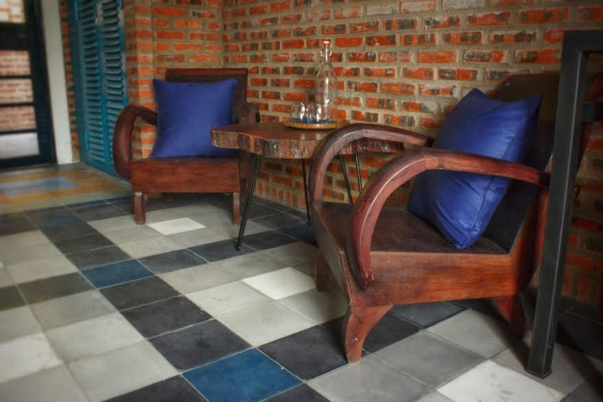 Traditional Vietnamese chairs in the poolside ensuite king room Compassion at the Gratitude Vietnam retreat venue in Hoi An