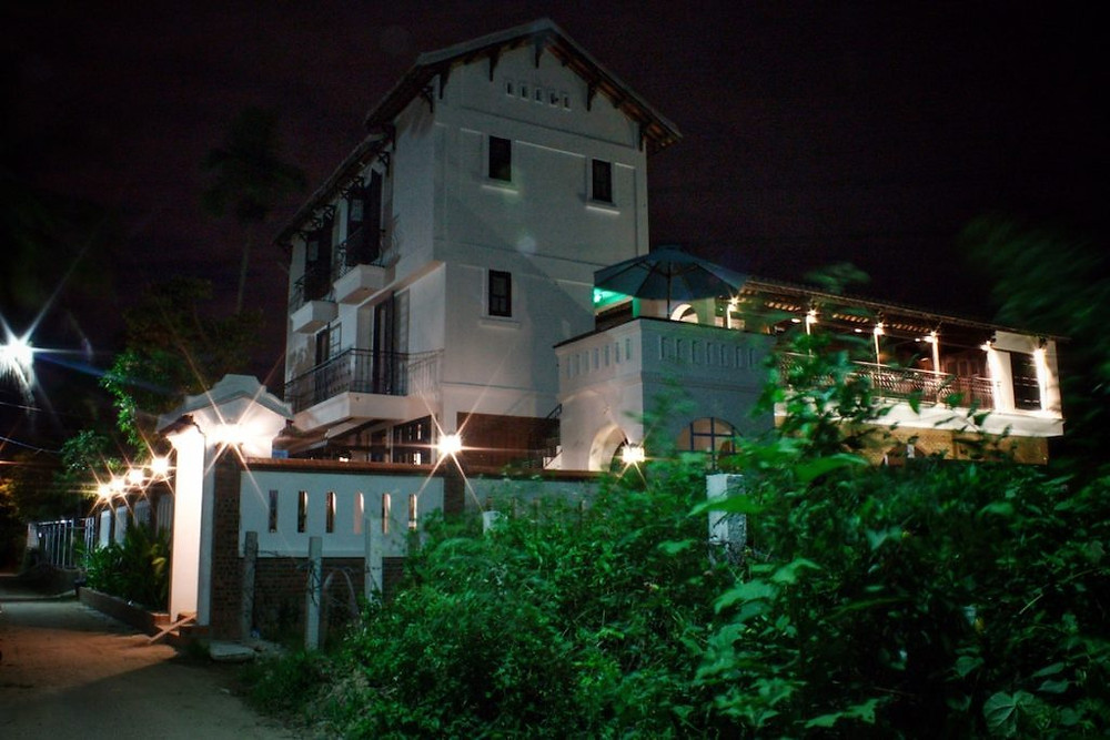 The Gratitude Vietnam Retreat Venue Villa at night.