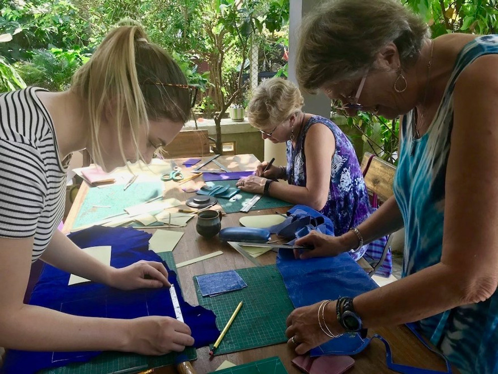 A photograph of Gratitude Vietnam family members enjoying a leather workshop in Hoi An.