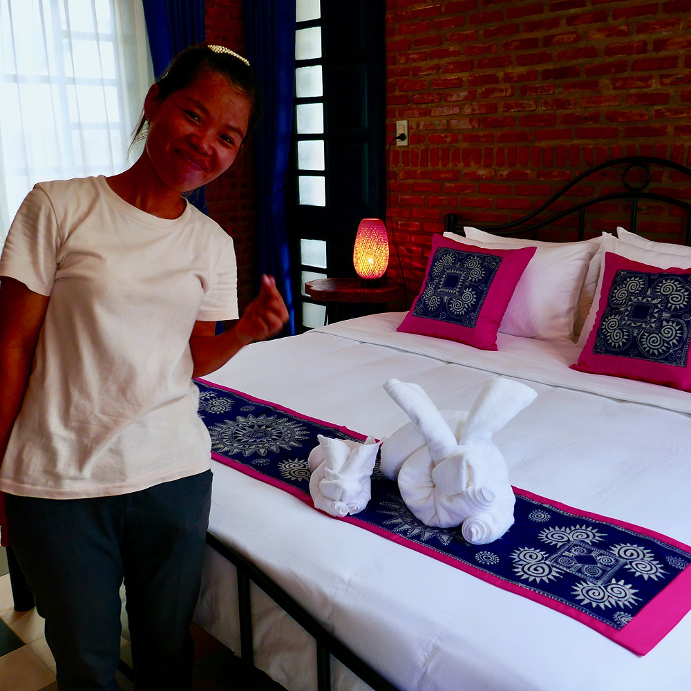 Phuong the lovely cleaner at Gratitude Vietnam Retreat in Asia, with origami towel Poppet and Bobo!