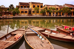 Boats on the Thu Bon river Hoi An Vietnam