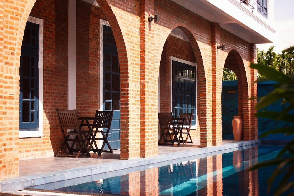 A photograph of the pool and poolside rooms at the Gratitude Vietnam Yoga Retreat Venue