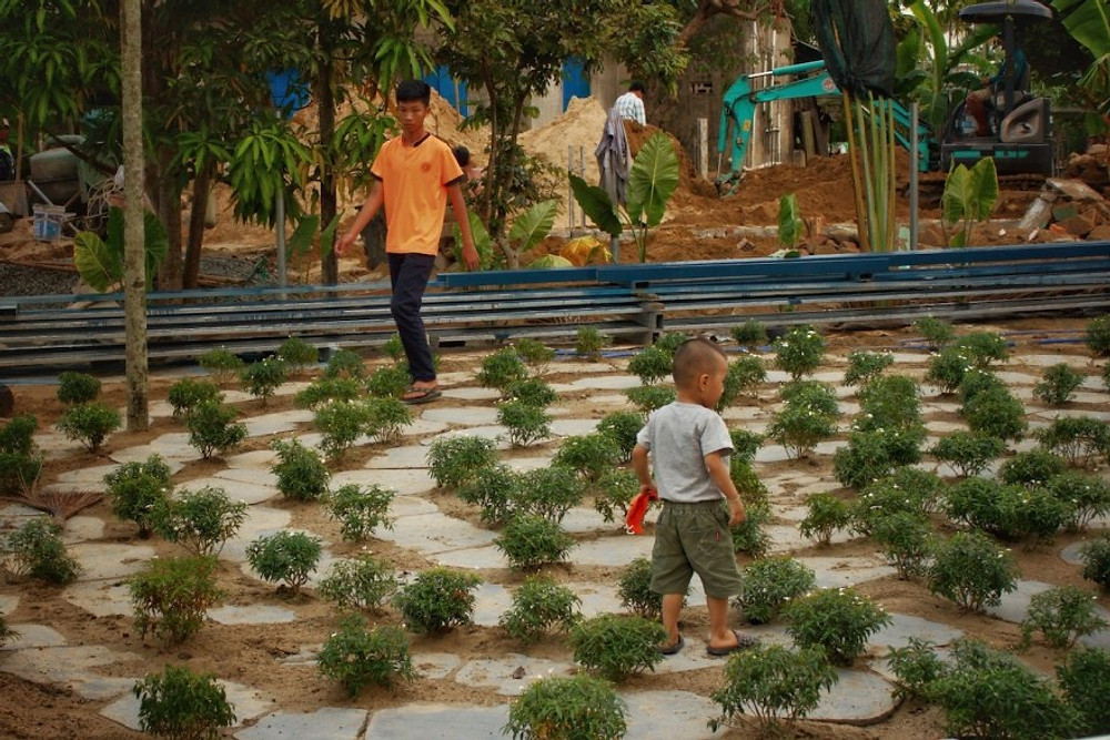 The nearly finished Meditation Labyrinth being used by two local boys in Construction at the Gratitude Vietnam Retreat Venue