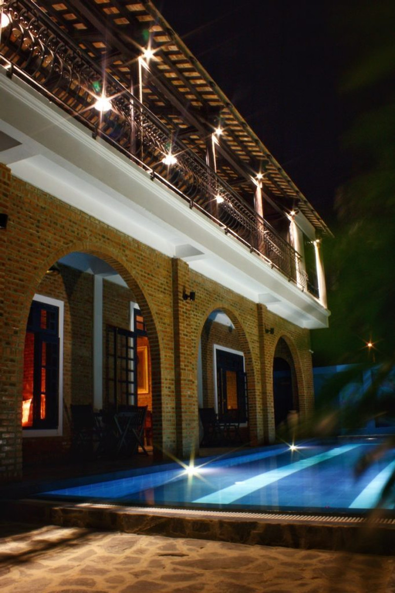 The Pool and Balcony at Night, at the Gratitude Vietnam Retreat Venue and Private Villa for hire.