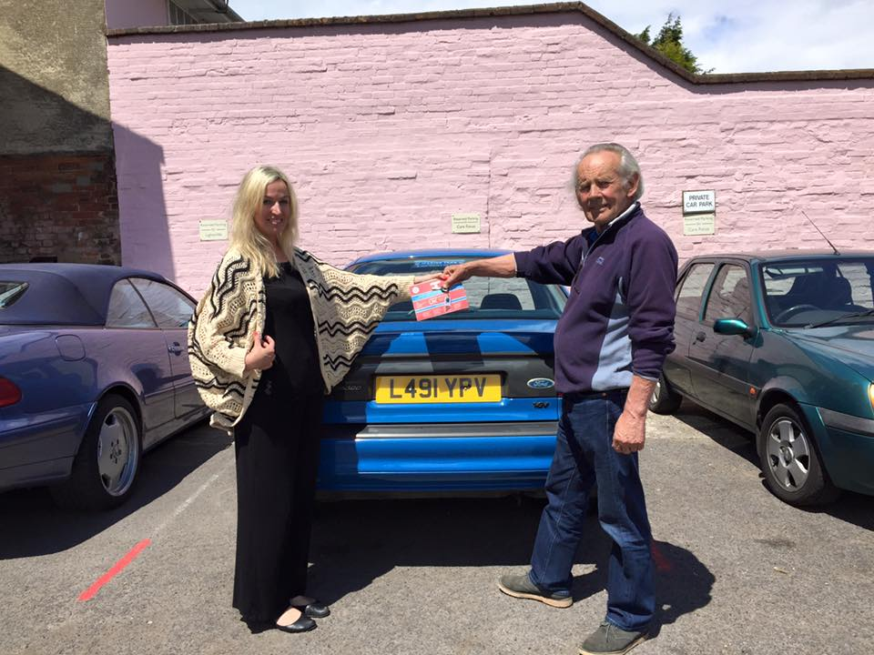 Steve presenting the lucky winner with her prize of a MK1 Mondeo