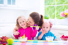 bigstock-Mother-And-Kids-Having-Breakfa-