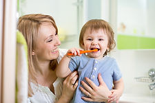 bigstock-mother-teaching-child-teeth-br-
