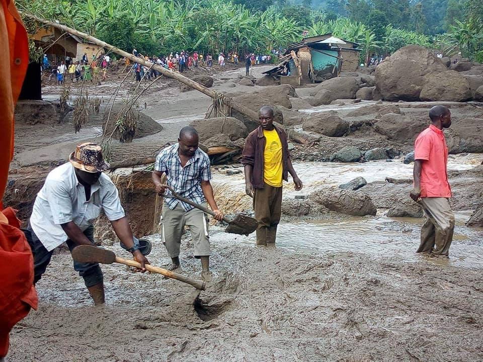 Moses shoveling mud from the landslide helping survivors locate lost loved ones.