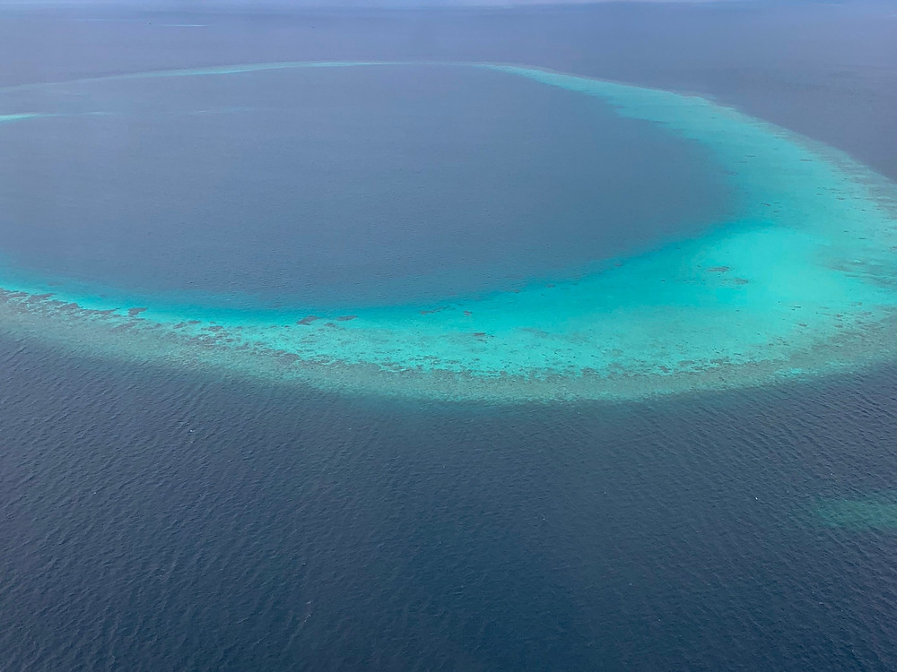 A view of a Maldivian atoll from a seaplane transfer.
