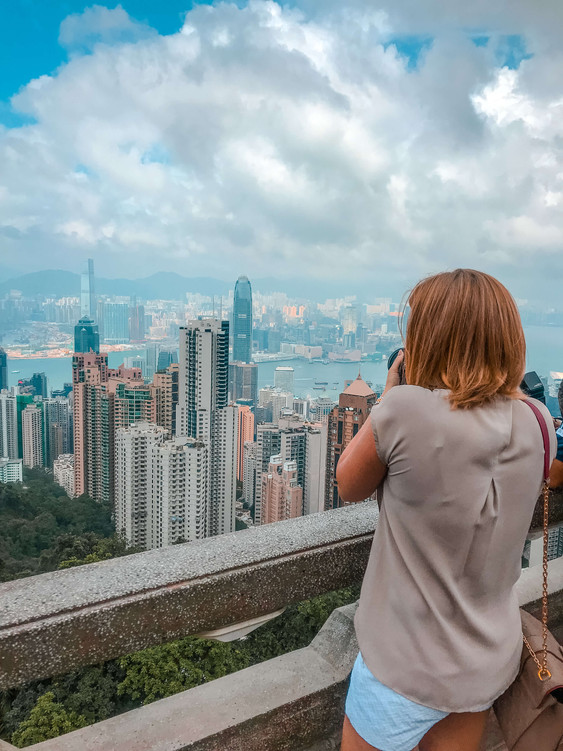 Taking a photo of the Hong Kong skyline