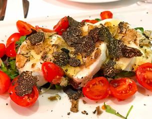 Caprese salad with black truffle