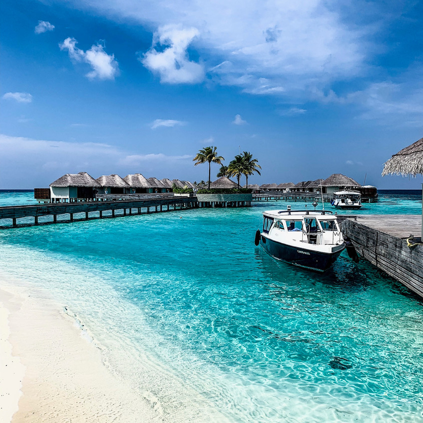 Looking from the beach out toward the overwater bungalows at the W Maldives.
