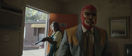 Crystal (Nickie Micheaux, left) and El Monstruo (Ricardo Adam Zarate, right) star in Lowlife (2017)