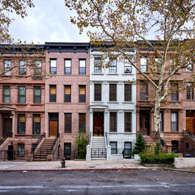 a view of a row of historic brownstones