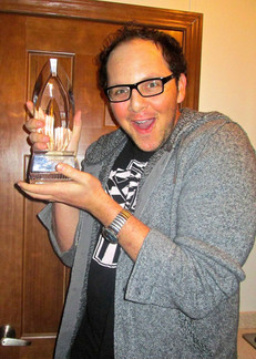 """Austin celebrating with the 2013 People's Choice Award for Favorite New TV Show for """"Beauty & the Beast"""""""
