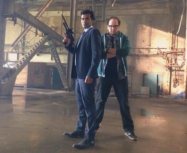 "Austin striking a hero pose with Sendhil Ramamurthy on the set of ""Beauty & the Beast"""