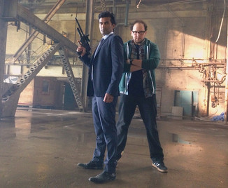 "Austin striking a hero pose with Sendhil Ramamurthy on the set of ""Beauty & the Beast"""