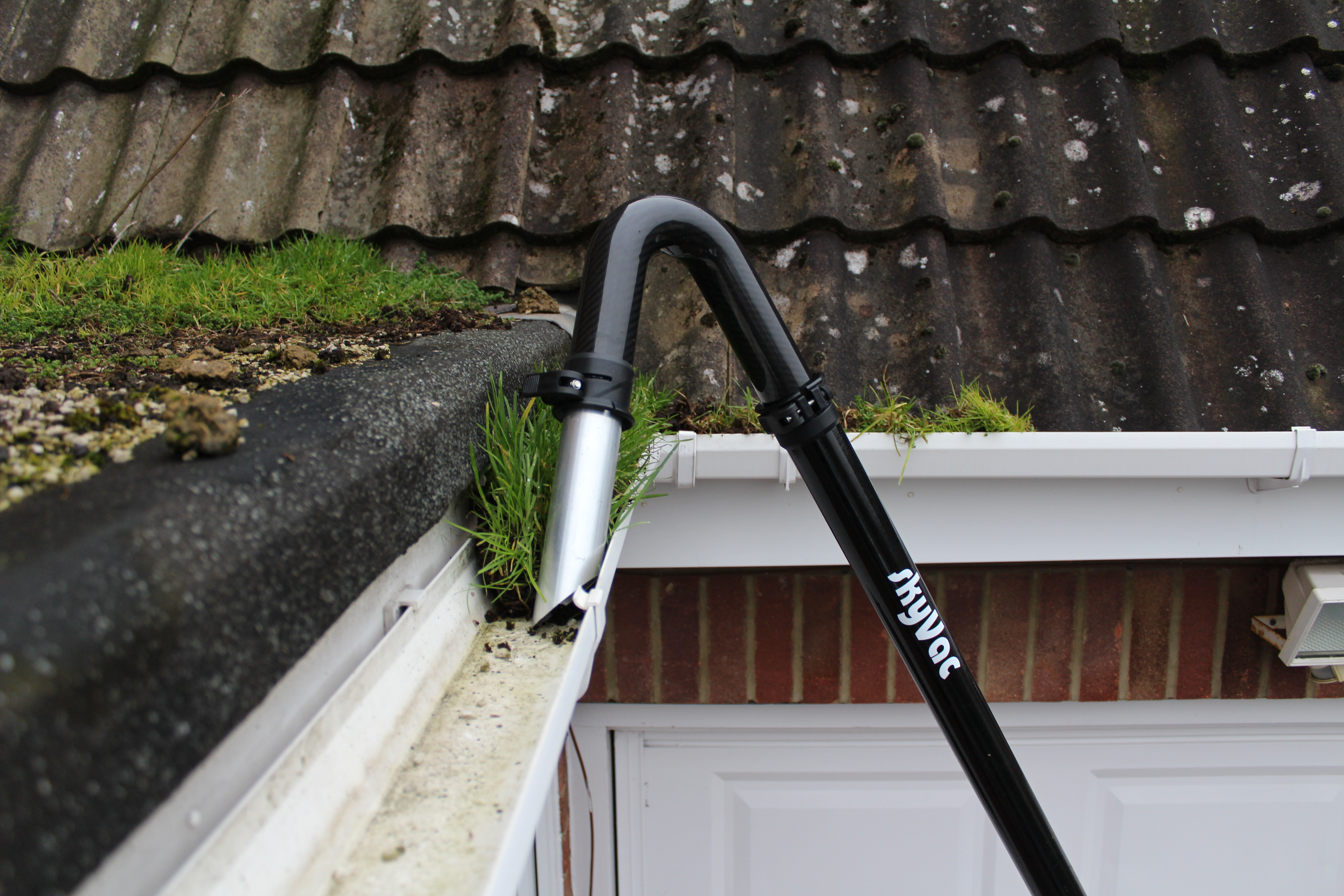 Gutter cleaning - grass in gutter
