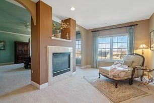 Real Estate Photography Master Bedroom with fireplace