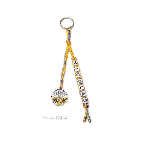 Porte clés bijoux de sac NICOLAS ABEILLE MIEL RUCHE personnalisé avec prénom nom message logo texte