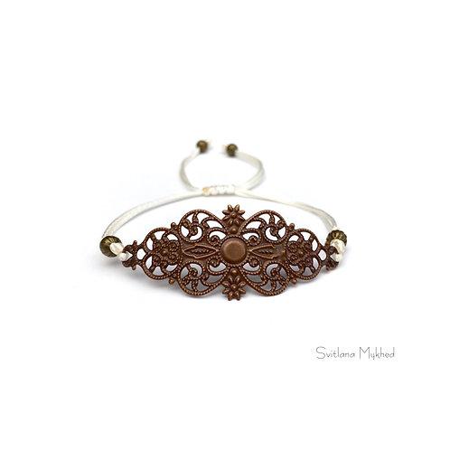 Bracelet fantaisie personnalisé Estampe Filigrane métal bronze, style retro. Création sur mesure