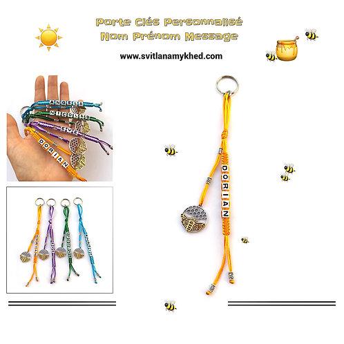 Porte clés bijoux de sac DORIAN ABEILLE MIEL RUCHE personnalisé avec prénom nom message logo texte