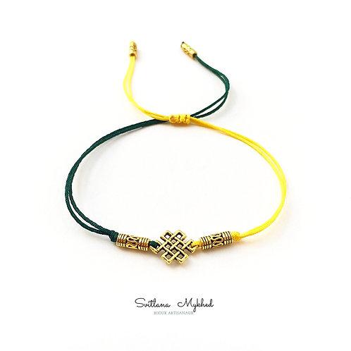 Bracelet personnalisé ethnique MOTIF CELTIC CELTIQUE. INFINI. ENIGME Perles tibétaines métal doré