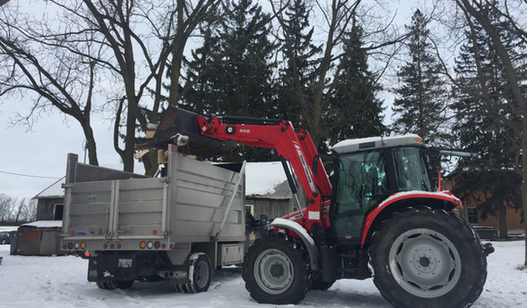 Loading firewood delivery