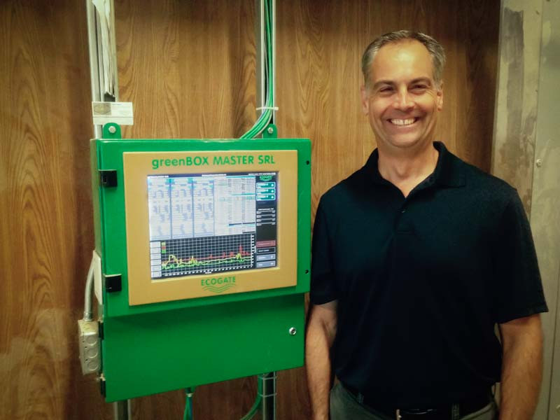 Plant Engineer Dan Wagner with the Ecogate greenBOX Master controller.