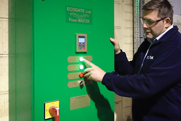 Operations Manager Paul Moxon inspects the Ecogate Power Master VFD at Routec GB.