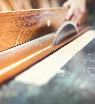 carpenter-sawing-wooden-planks-PXNU9TD.j