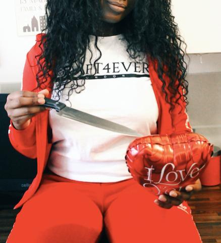 blogger cutting through heart balloon