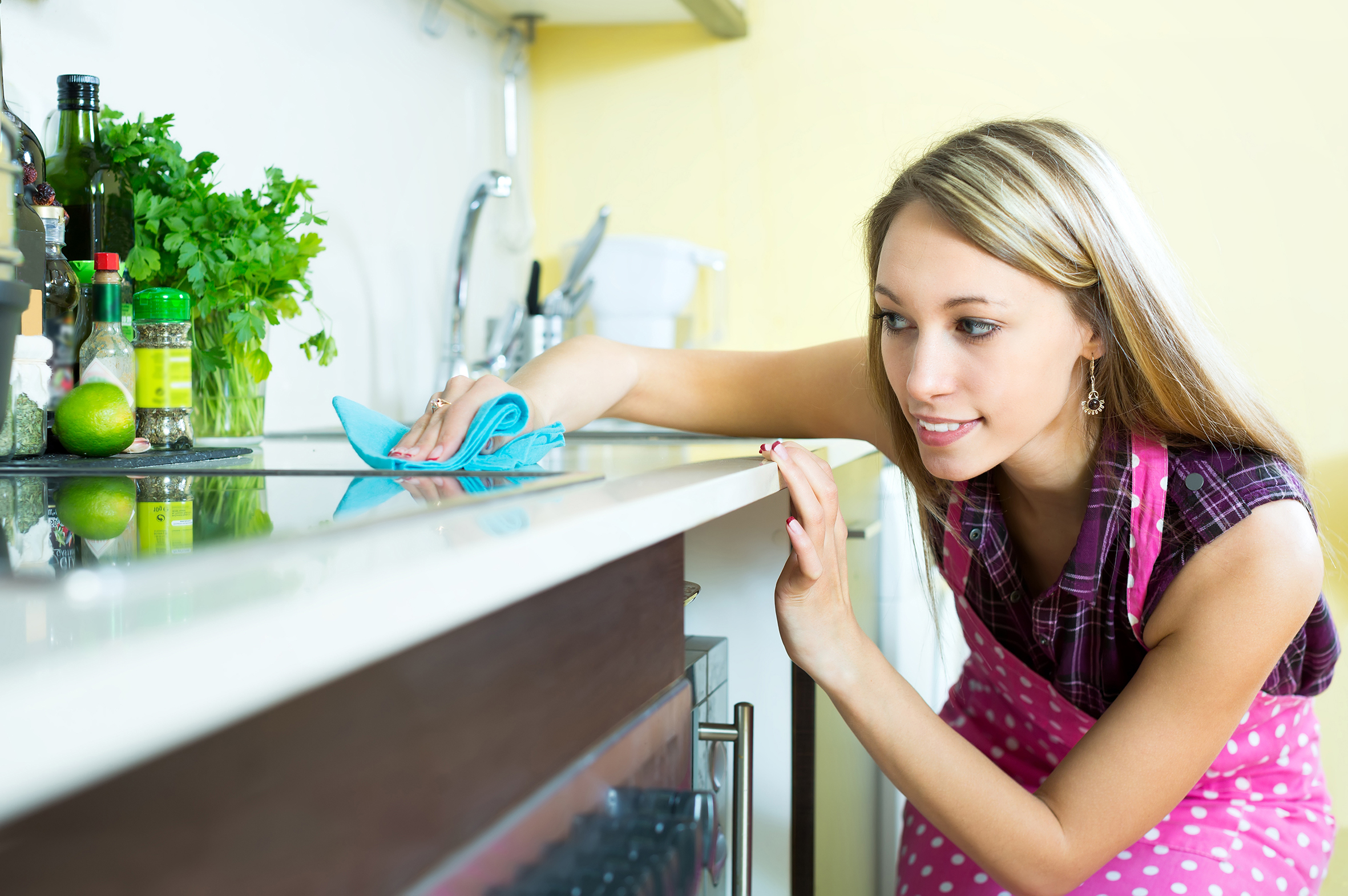 women cleaning kitchen top