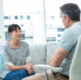 Woman consulting a therapist in clinic.jpg
