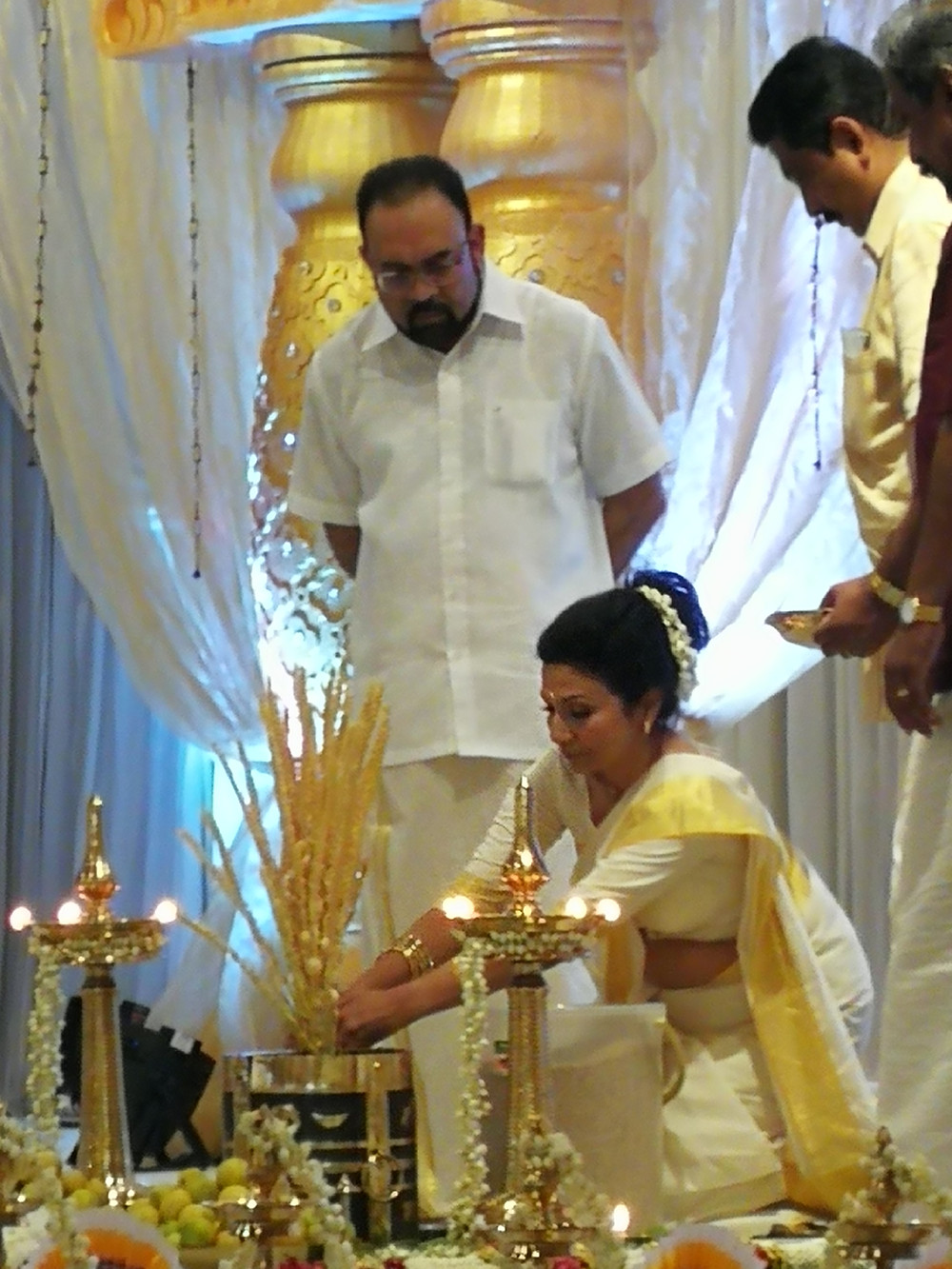 Dato' Fredrick and Datin Rufina at the ritual of Bride's Mother Lighting the Lamp.