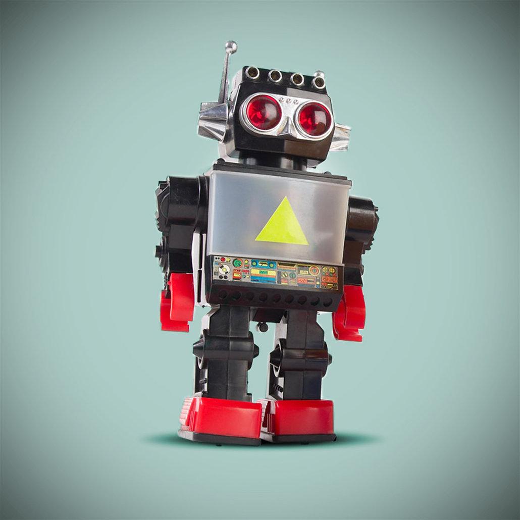 青色の背景に黒のロボット