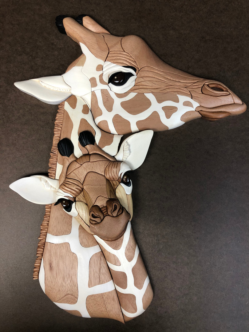 Intarsia giraffs $475.   SOLD