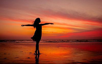 woman-standing-on-beach-during-sunset-4_0.jpg