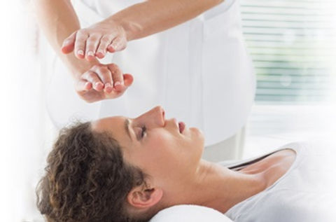 reiki_hands_over_head_494372603_01.jpg