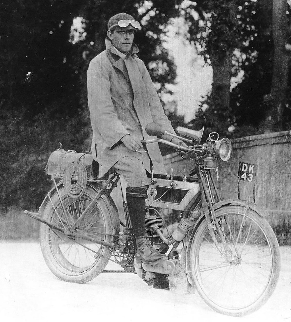 Ixion seated on his 1905 Triumph belt drive motorcycle