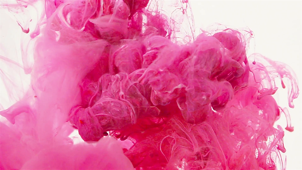 pink-color-paint-slowly-flowing-in-water