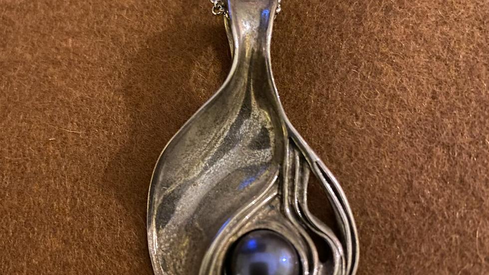 silver art nouveau style pendant with silver chain