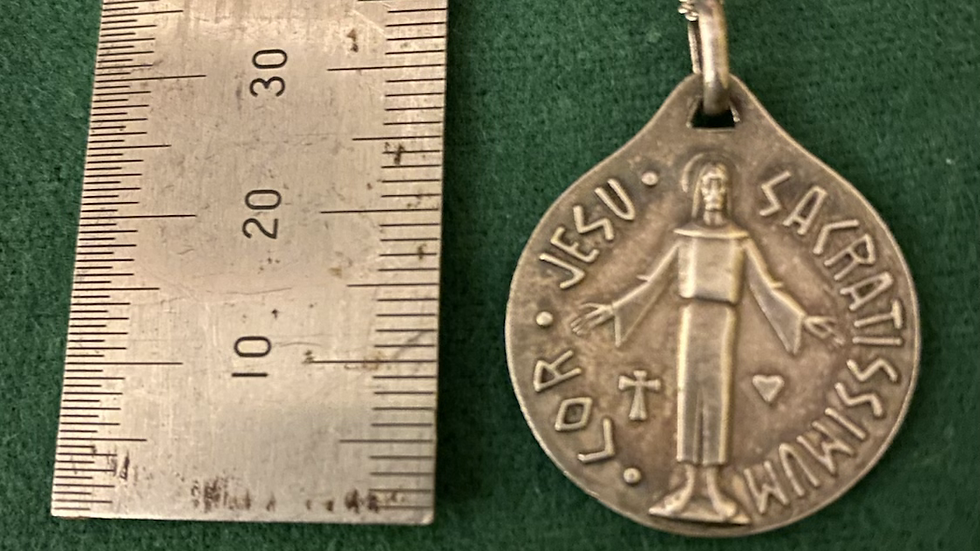 religious pendant and silver chain