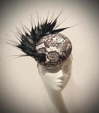 Snake print button with spiky goose feathers