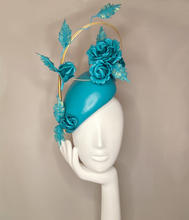 Teal leather teardrop with leather climbing roses and gold quill
