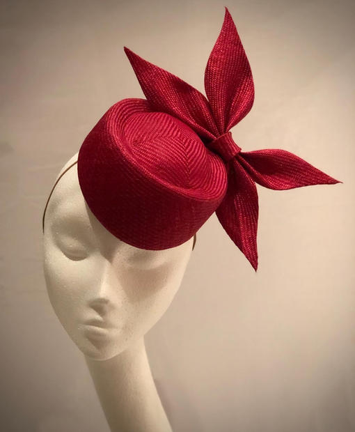 Deep red straw percher with pointed bow