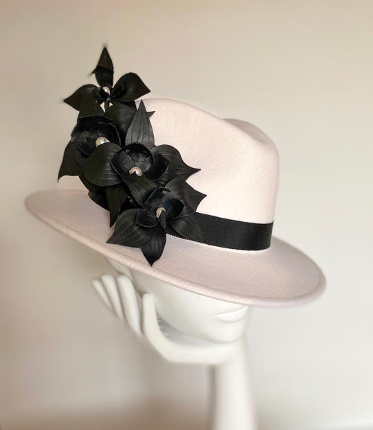 Winter white fedora with black leather orchids